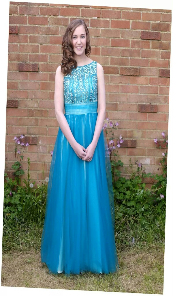 This is the my prom dress. I wore it last lear for my year 11 prom and havent worn it since. i'ts  in perfect condition  only  £85
