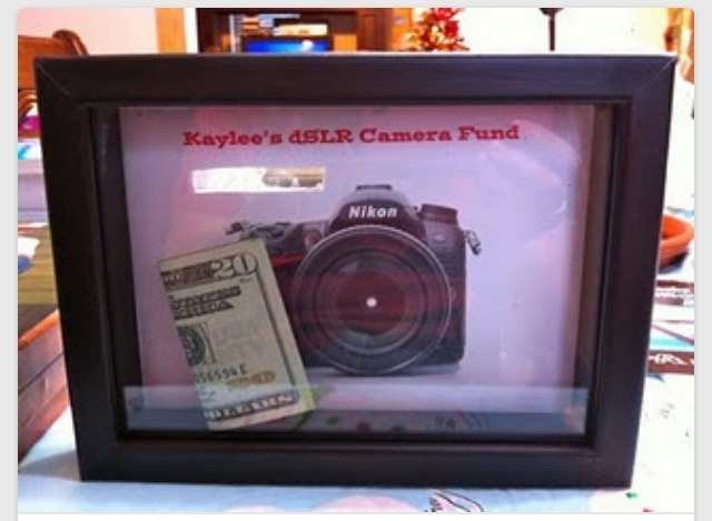 Put a photo of your goal purchase, like a camera or a vacation, in a shadow box and use it as piggy bank! Love this idea!