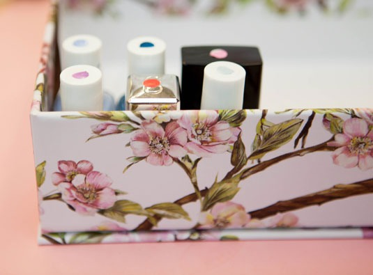 8. Store your nail polish upright in a box with painted stickers on top to indicate the colors.