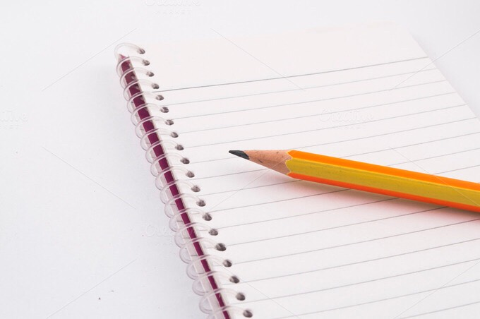 Notebook and pencil! You can draw, write about your trip, predictions of your trip, play hangman, there a lot of options!
