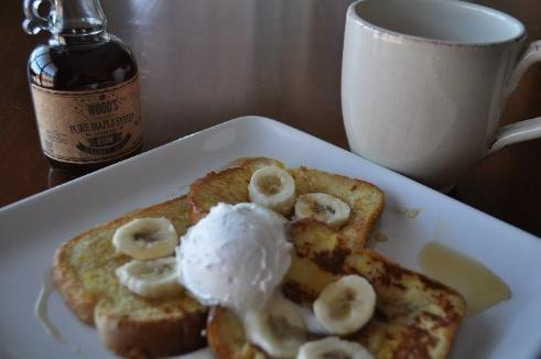 French toast topped with Wood's Vermont Rum Barrel Aged Maple Syrup, warm bananas and whipped topping.   What a great way to start your morning!