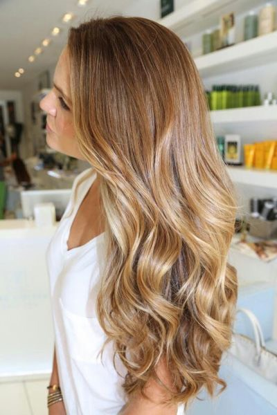 The best way to infuse some new life into every natural hair color is to ask for brightening face-framing highlights and a subtle ombré.