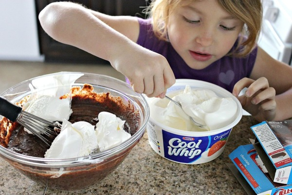 Once combined, have them add the Cool Whip and gently mix it together.