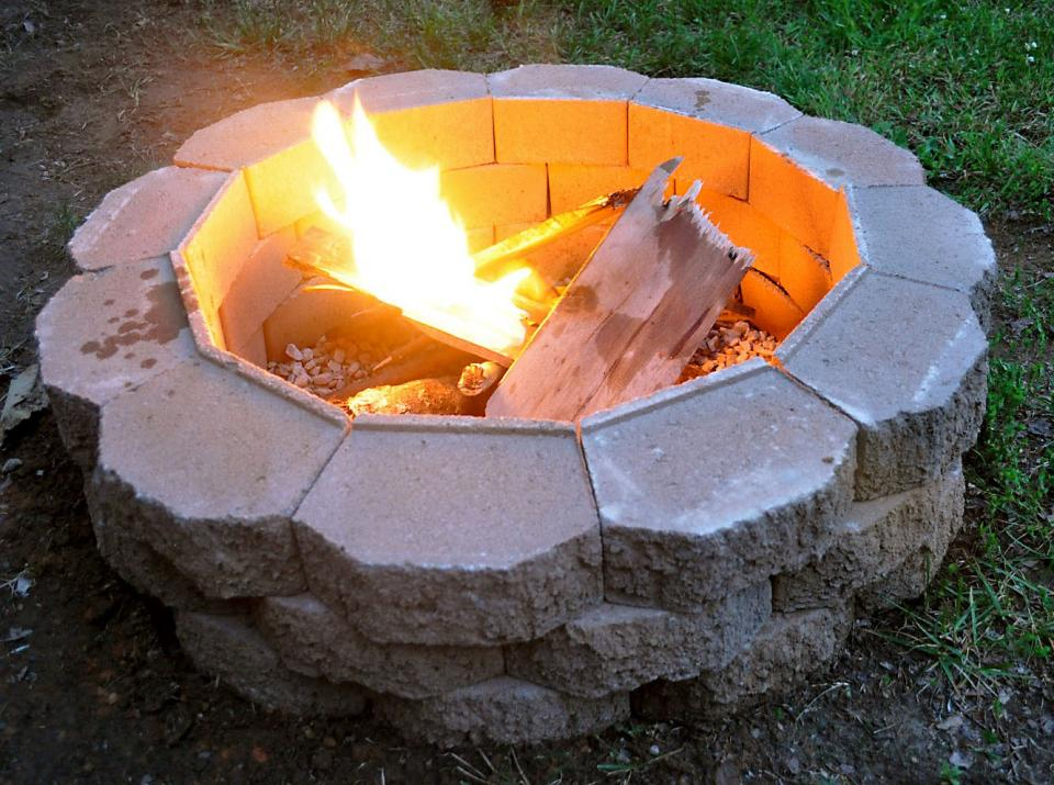 Fire-pits are so fun to have in the backyard. They're great for parties and they make the best hot dogs and s'mores. If you don't have one already, you've got to build one!