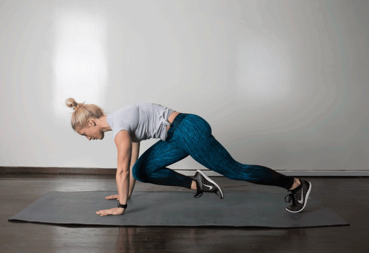2. Mountain Climber  From a high plank position, with your body straight and hips level, lift right foot and draw right knee to chest between your hands. As you return right leg to plank, lift left foot and draw left knee to chest between your hands. Continue to alternate as quickly as possible, keeping your core tight and without hiking your hips.