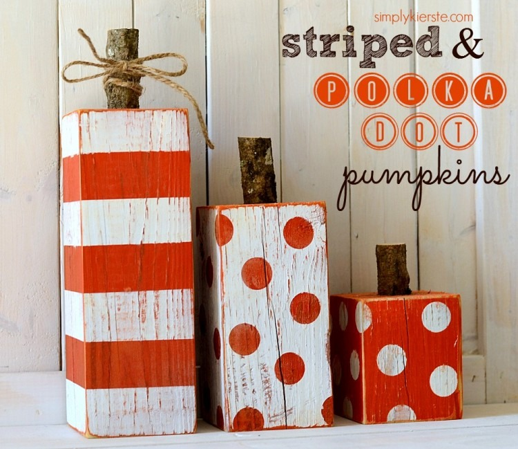 supplies needed: 3 wood blocks orange&white acrylic paint, 3 small chunks of wood, string.  how to: paint a white base over the wood blocks. let dry for 1hr. After dry you can either do orange polka dots or stripes on the blocks. now hotglue the wood chunk to the blok. Finish it off by tieing string
