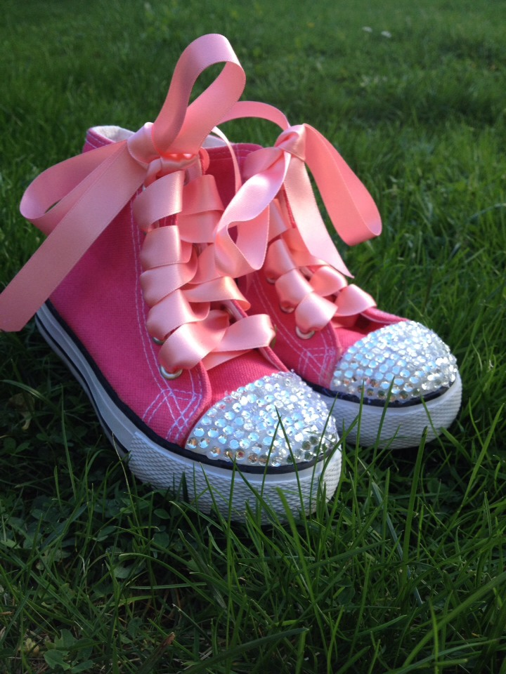 I did this with a glue gun, gems, and ribbon took about 1 hour per shoe and cost me about £4 looks great and the little princess that wears them loves it!!!