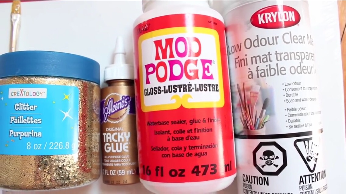 This is the stuff your going to need  Canvas  Tacky glue Mod podge(glossy finish) Tub of glitter  Krylon clear matte or hairspray might work as well