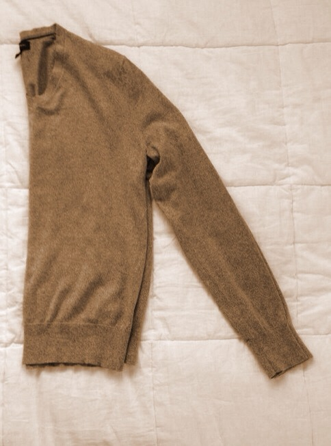 --> Start by folding your sweater in half.