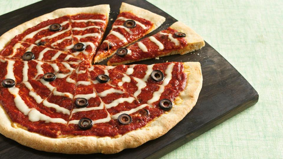 You'll nab their attention with this eye-catching pizza. Paint the web with refrigerated Alfredo sauce.