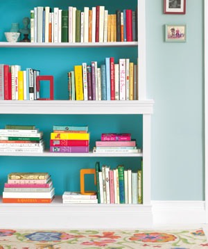 Then simply lift them up and on to your shelf and admire your newly organised bookshelf!! 📚