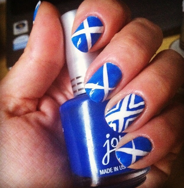 This was soooo easy! I used a white base coat, cute strips of scotch tape, placed them, then pained the blue. For the accent nail I painted the additional outside lines with a brush.