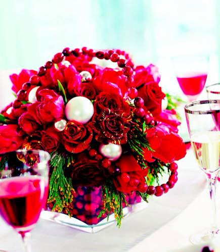 Cranberries and roses  Start with an 8-inch square clear-glass vase. Cut a piece of floral foam to a size that lets a layer of cranberries fit between the foam and the vase. Cover with water. Insert red roses, striped 'Hocus Pocus' roses, red tulips and gold-tipped cedar (check your local florist)