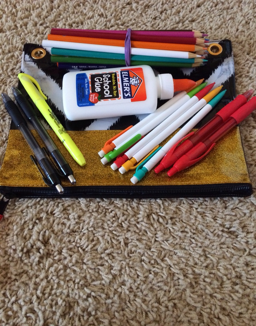 •4• Keep essentials like these in your pencil pouch: pencils, pens, highlighters, colored pencils, and glue.