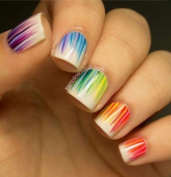 Put polish on the end of a toothpick. Start at the bottom of your nail and drag up