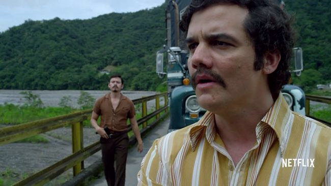 """""""NARCOS""""Netflix'soriginal drama aboutfamed cocaine dealer Pablo Escobarilluminates his backstory while bringing him 1 step closer to his inevitable demise, all the while showing a somewhat endearing man consumed by his own ego.  Narcos is a much-needed prescription that'll scratch your itch."""