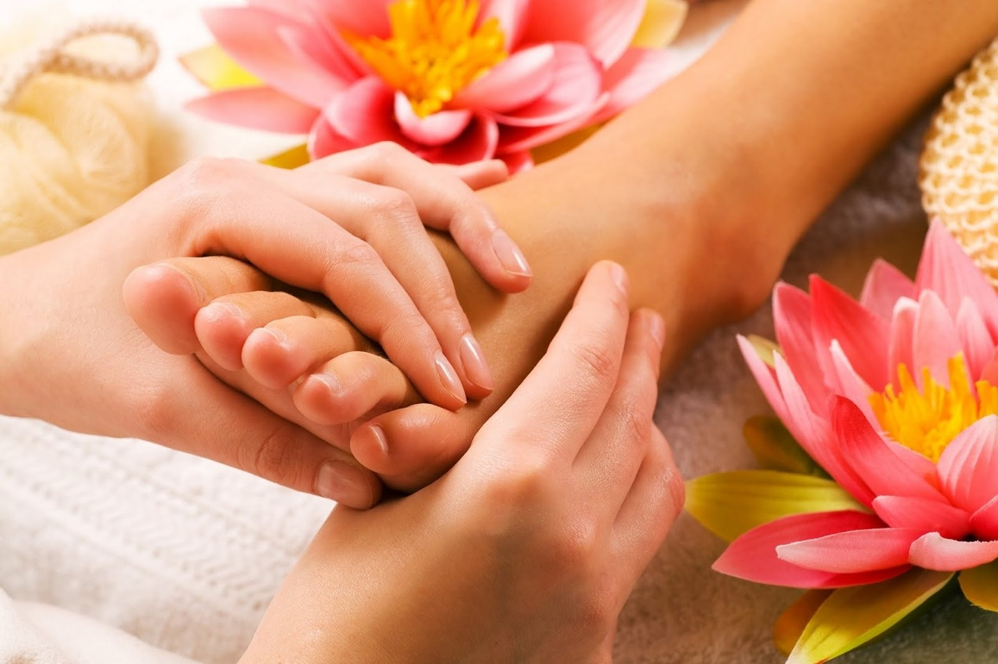 Dry your feet, then apply a mixture of olive oil and coconut oil to desired areas of the foot.