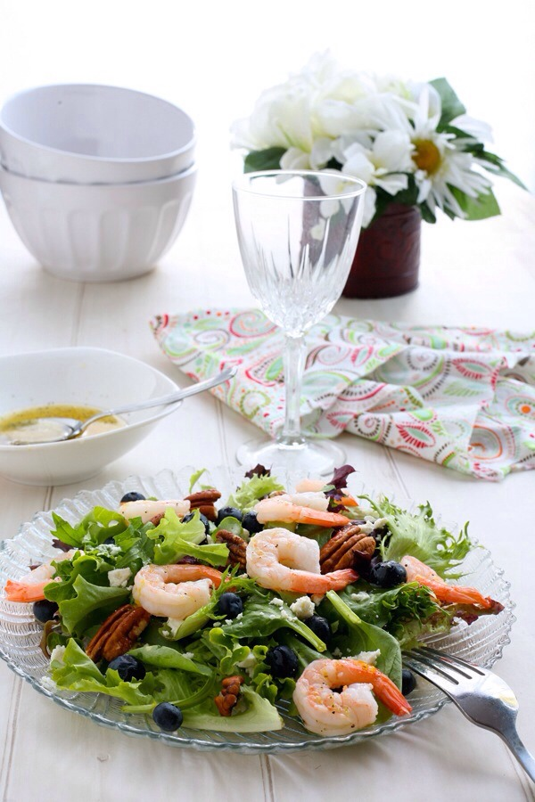Blueberry Shrimp Salad with Lemon DressingBlueberries are still in season, and this salad is a great excuse to take advantage of that. Mixed with pecans, feta, and shrimp, this odd combo not only looks beautiful on the plate, but will feel good in your belly, too!