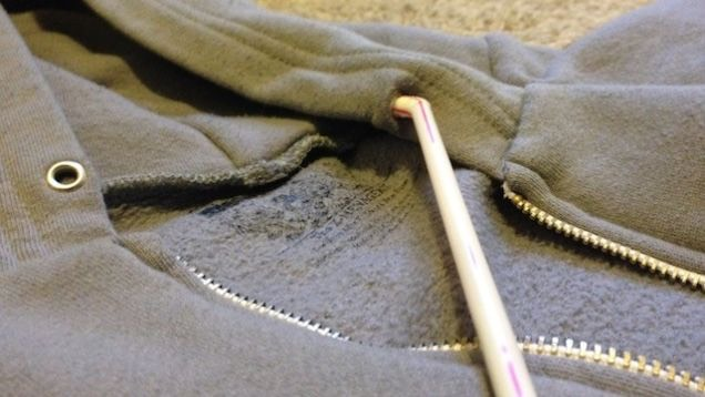 14. Put the string of your hoodie back into the hood by threading it through a straw.