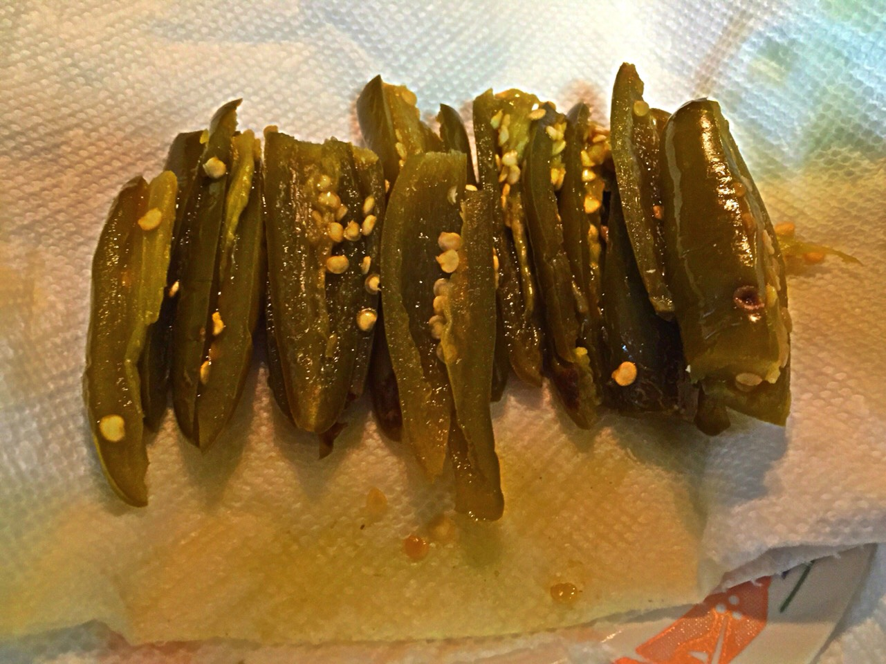 Place the jalapeños on a paper towel to soak up any excess vinegar.