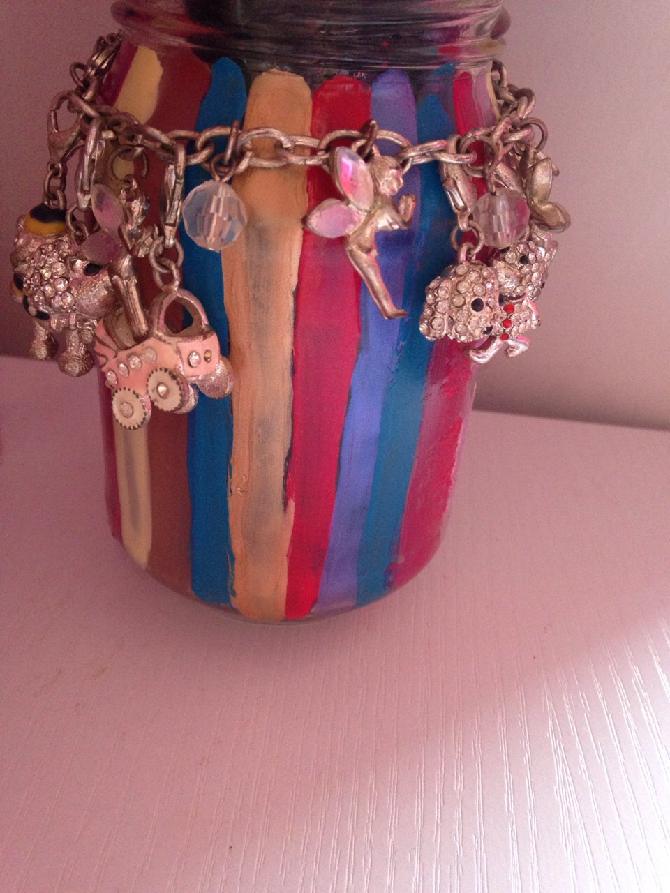 Get an old pot and put a bracelet around it to look cute