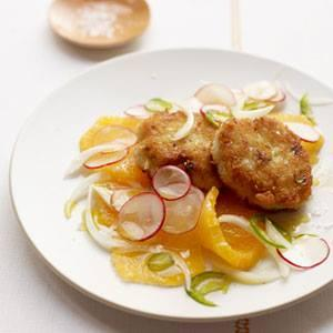 coated in panko bread crumbs and served with a fresh citrus salad.  Cod Cakes with Orange and Radish Salad