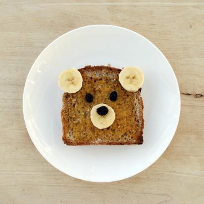Now even as adults everyone can agree toast in a pretty basic food choice. take bananas and raisins to create this cute bear!