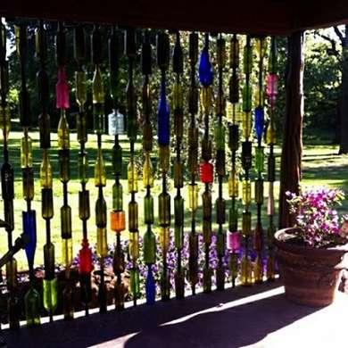 Patio Bottle Wall  Just like stained glass, this multicolored wall of bottles takes on a magical appearance with the changing light of day. Though the project does require drilling a hole in the bottom of the bottles, it's easy enough for even a novice DIYer.