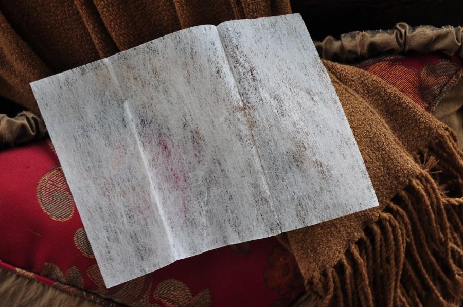 Rub dryer sheet to dry or frizzy hair to tame the frizz.
