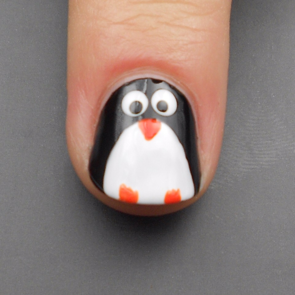 Step 6:  Finally, use the same orange polish with the tiny paintbrush again to paint three little toes for each foot!
