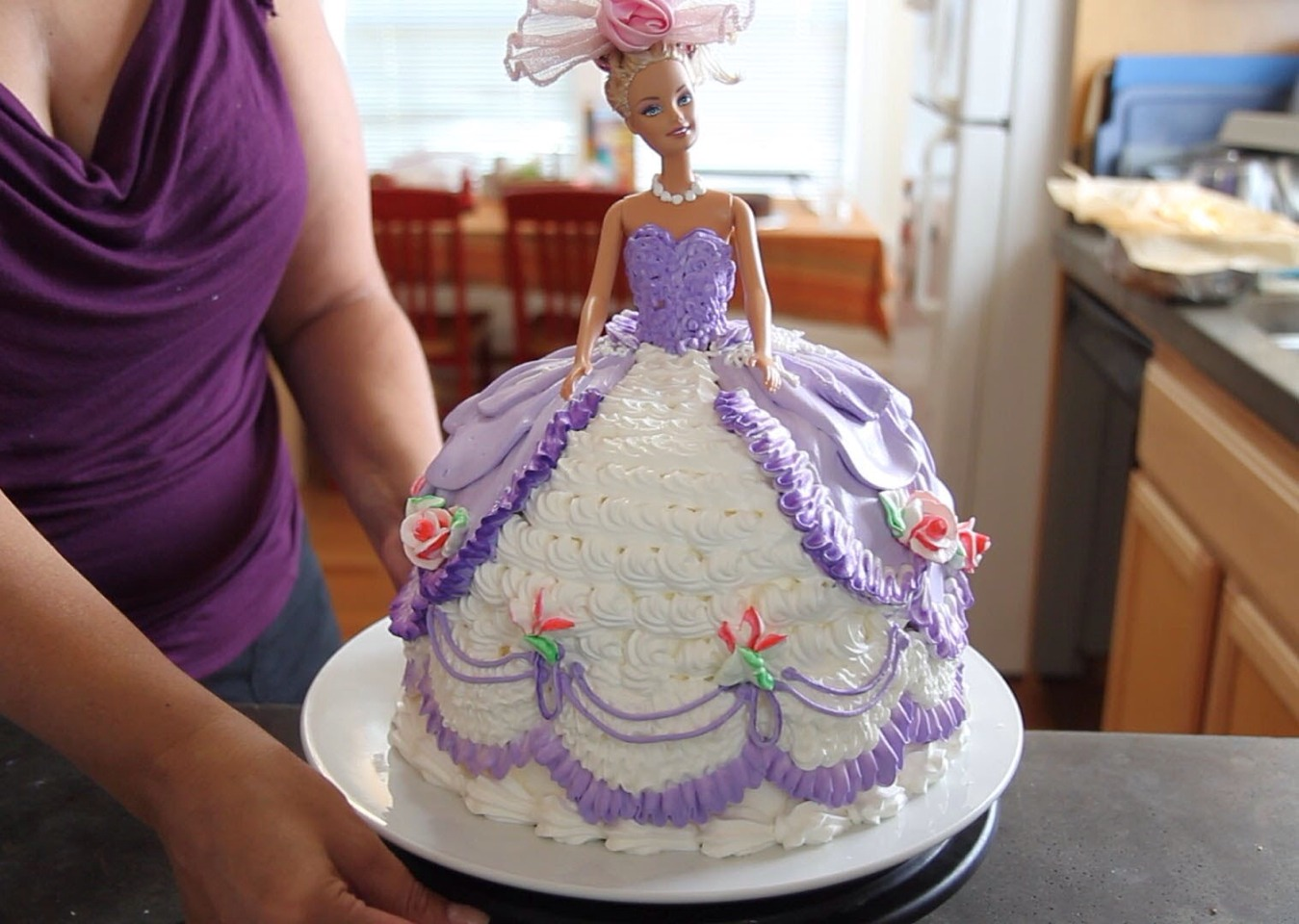 Flip it upside down and put the Barbie through it.  Ice the cake however you desire! Cute for children!!! And easy/low cost