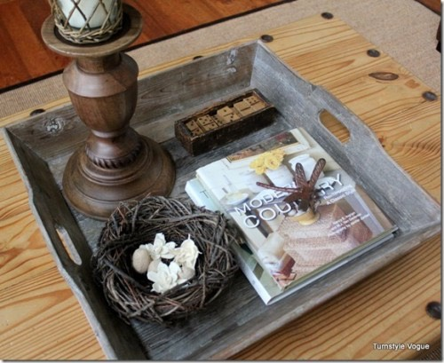 Corral Odds & Ends On A Tray: Use a tray that balances on your coffee table or sofa to group and store items. It gives the look of organization and keeps things handy!