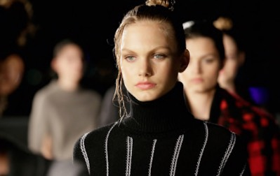 7.Thakoon  Continuing with the wet hair trend, Thakoon showcased these topknots with loose, wavy tendrils.