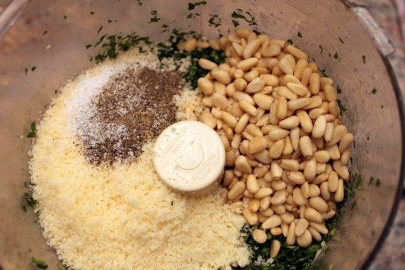 Step 4. Add the pine nuts, Parmesan, salt, and pepper. (You can substitute walnuts for the pine nuts, if you prefer them.)