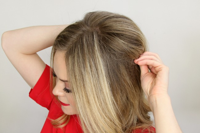 Step 2 / Take the same portion of hair and wrap it towards the back of the head.