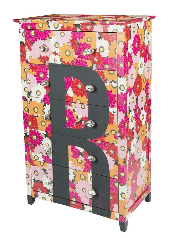In a Day: Wrap It Up Wrapping paper isn't just for gifts. Here, HGTV Magazine used a floral roll to transform this basic furniture piece. A stenciled monogram sends it into the uber-preppy zone.
