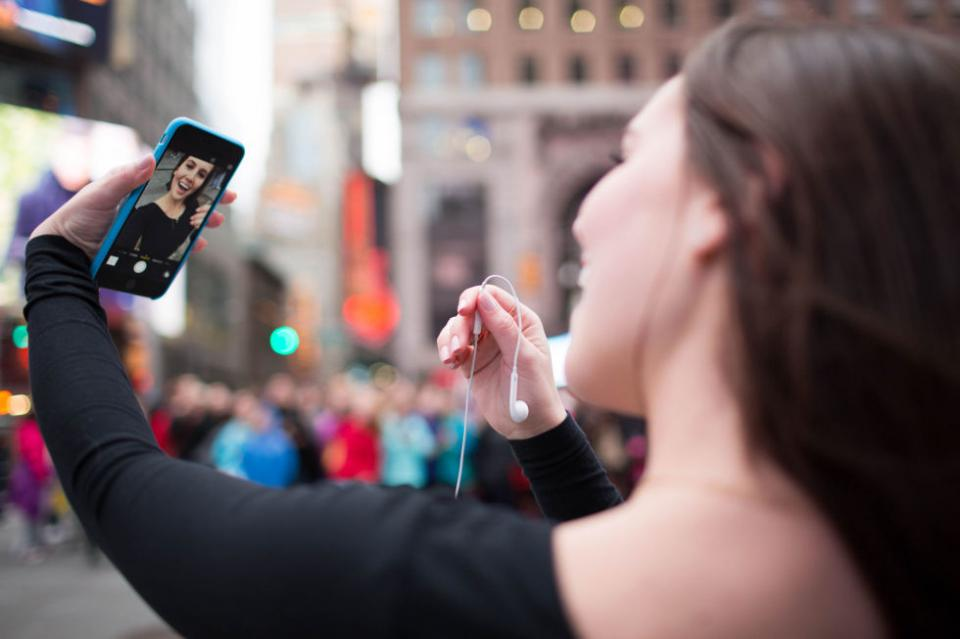 13. If you've found the perfect camera angle but can't reach the shutter button, try plugging in your earbuds and using the volume buttons on the cord instead. This is a great tip if you want to prop your phone up and take the picture from a distance for a wide-shot selfie or a group photo.