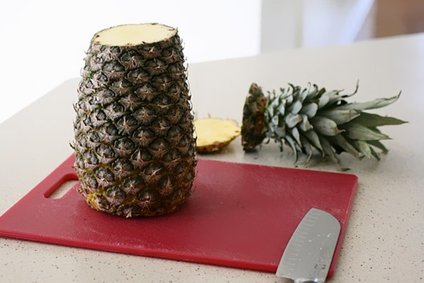 Prepare thing slices of the pineapple. You can use the head and the bottom which you don't eat and throw away anyway.