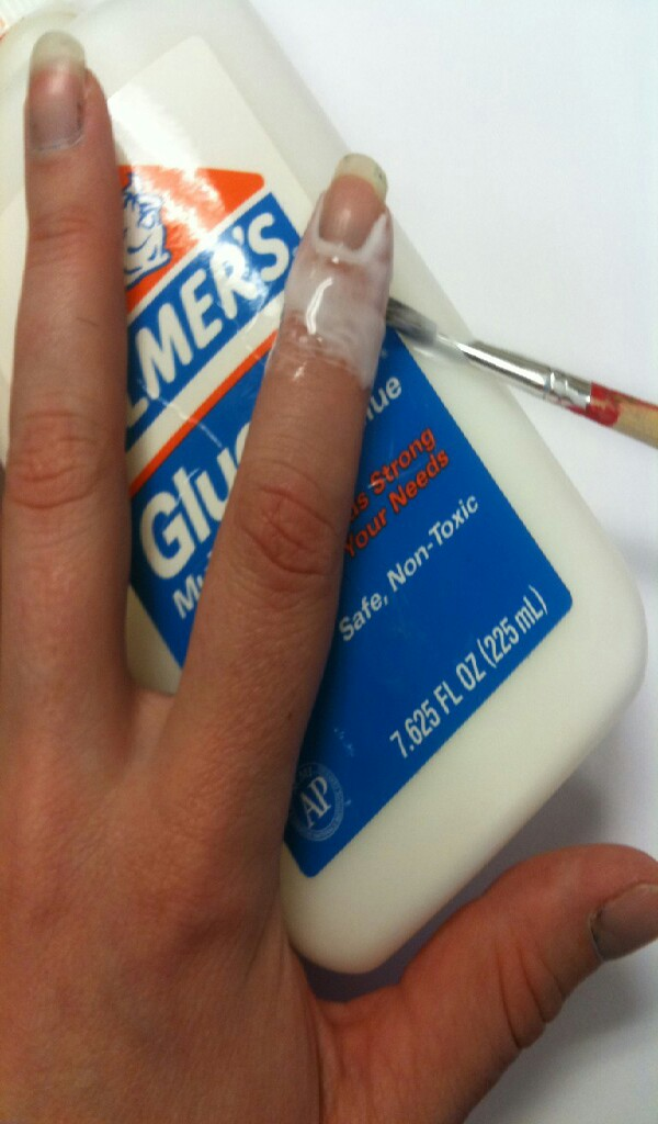 2.Paint a coat around your nail with elmers glue and let that dry