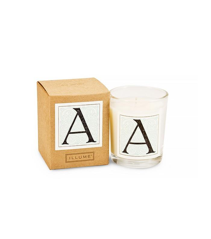 The Scented Dream  Illume Candles Monogram Votive Candle ($12) How cute and special are these candles? The all-natural soy and beeswax blend burns off a beautiful scent of mandarin, vetiver, vanilla, and tobacco leaves.
