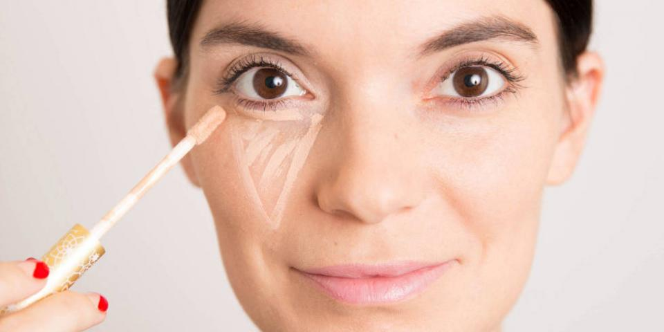 13. Under Eye Concealer  You could pack a pair of sunglasses, or you could pack a quick-swipe concealer to hide the dark circles under your eyes.