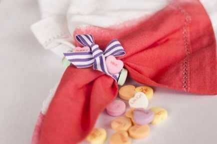 Make a Bow!  Wrap your ribbon around the napkin, and tie it with a bow. Cut the ends of the ribbon if they are too long.