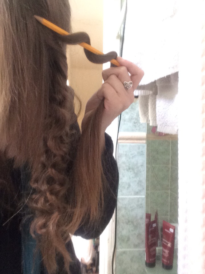 First wrap your hair around the pencil (as shown above)