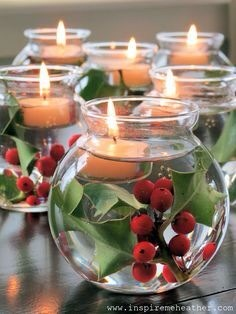 Create a simple centerpiece with holly in little vases. Fill with water and then add a tealight.