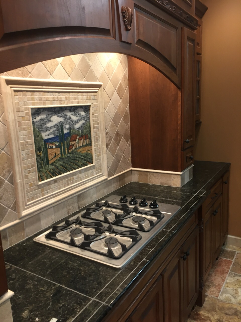 Gorgeous kitchen! The mural makes it seem like a nice Window over looking the country side