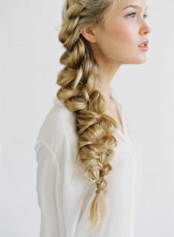 Instead of scrapping your hair back into a tight pony tail, put it in a side braid
