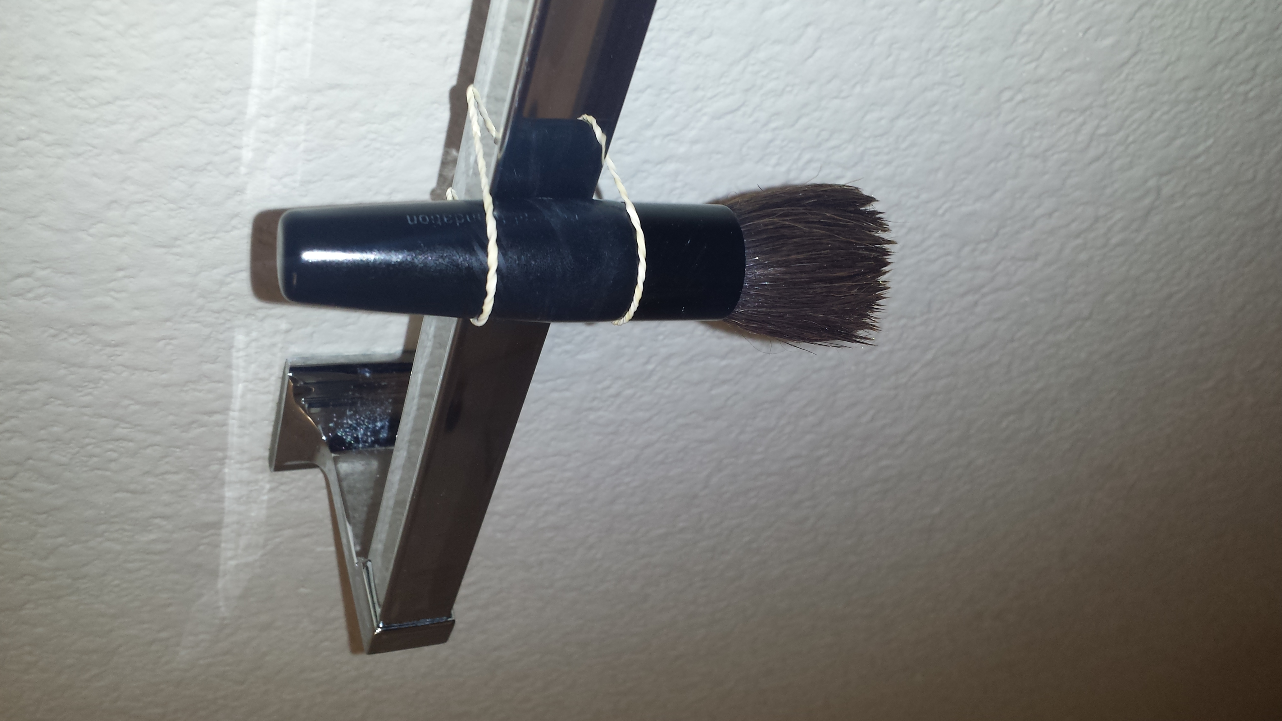 and then hang it on the towel holder with your hair tie facing down p.s. i recomment doing this at night so that in the morning all your brushes are dry