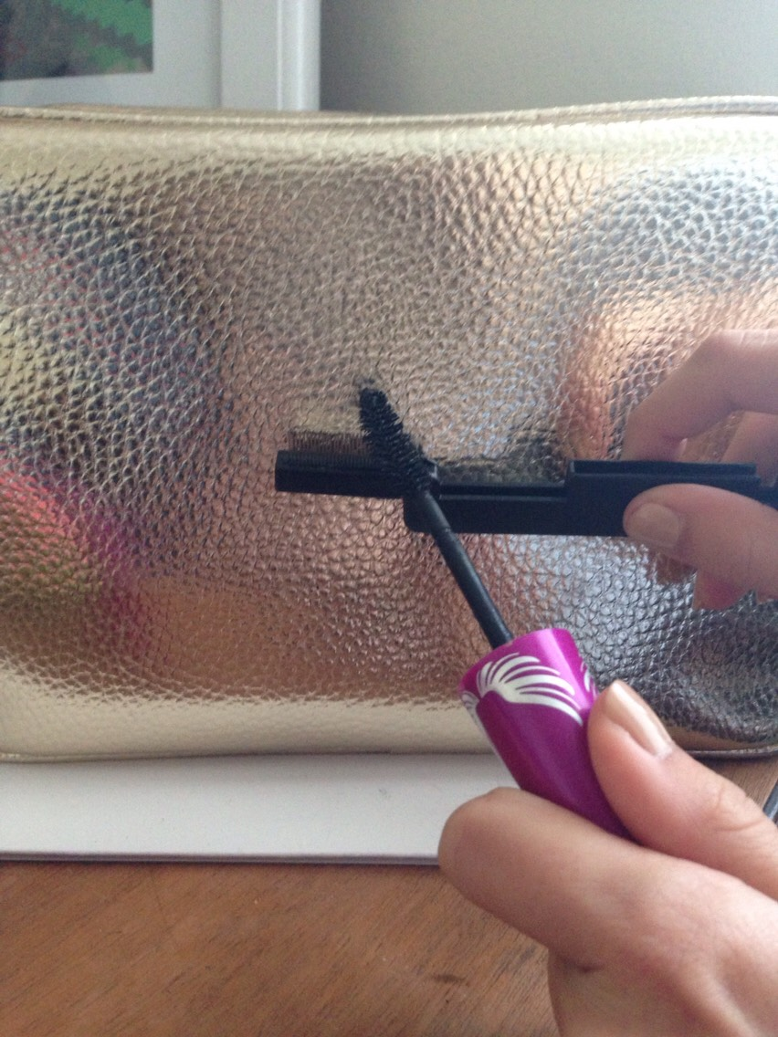 Rub the mascara wand across the wire comb