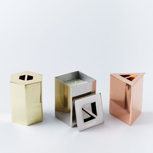 Geo-Metal Scented Candles  Geometric decor is still totally in. These metallic-finished candles are perfect and small enough to go along your bathroom cabinets or sink.