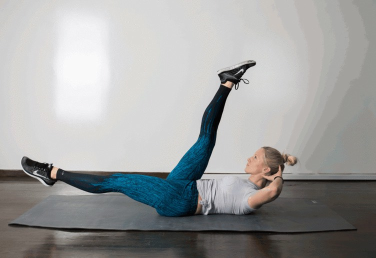 3. Scissor  Lie faceup, hands behind your head, lifting head and shoulders off the floor. Using your abdominals, lift legs slightly off the ground and scissor kick, alternating one up and one down. Focus on not straining your neck or jutting your chin forward.